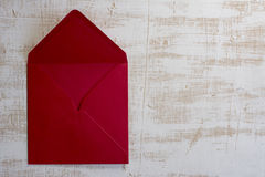 Red envelope, white  wood background Royalty Free Stock Photos