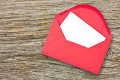 Red envelope on wooden background stock photography