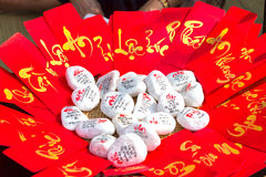 Red envelopes with the fortune-being wellbeing beautiful. Rocks next to the write calligraphy is also for sale in the first day was beautiful and meaningful Stock Photo