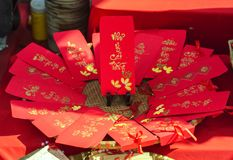 Red envelopes Lunar New Year Calligraphy decorated with text `Merit, fortune, longevity` in Vietnamese. Means anyone receives money from envelope will be lucky Royalty Free Stock Image