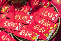 Red envelopes Lunar New Year Calligraphy decorated with text `Merit, fortune, longevity` in Vietnamese. Means anyone receives money from envelope will be lucky Stock Image