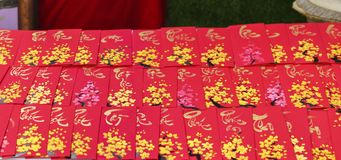 Red envelopes Lunar New Year Calligraphy decorated with text `Merit, fortune, longevity` in Vietnamese. Means anyone receives money from envelope will be lucky Royalty Free Stock Images