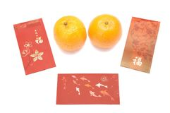 Red envelopes and a pair of mandarin oranges royalty free stock photos