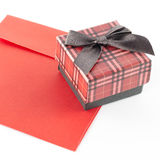 Red envoloper and scotch gift box isolated on white Royalty Free Stock Photo