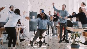 RED EPIC-W Happy young black businessman celebrating birthday at office workplace party with confetti slow motion. RED EPIC-W Helium Cinema. Happy young black stock footage