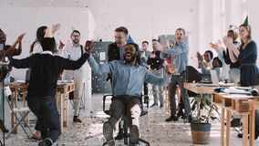 RED EPIC-W Happy young black businessman celebrating birthday at office workplace party with confetti slow motion.