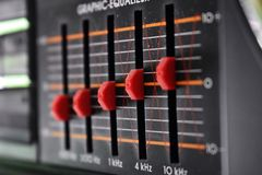 Red equalizers on the old black radio royalty free stock images
