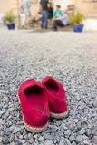 Red espadrilles in the foreground royalty free stock photos