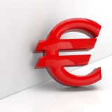 Red Euro sign in 3D. Leaning on a grey wall Stock Images
