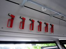 Red evacuation hammers on German public transport, translation on the windows is emergency exit.  Royalty Free Stock Images