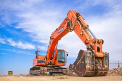 Red Excavator on Dry Field royalty free stock images