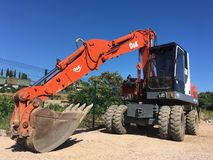 Red excavator for rent. Red excavator in good condition waiting for being rent under the sun royalty free stock photography