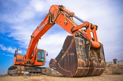 Red Excavator Under the Blue Sky stock images