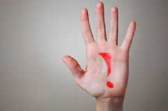 Red Exclamation Mark on a Hand Royalty Free Stock Photos