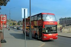 Red excursion citysightseeing bus on Bolotnaya Square. Moscow royalty free stock photos