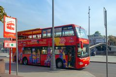 Red excursion citysightseeing bus on Bolotnaya Square. Moscow stock images