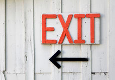 Red Exit Sign on an Old Barn. A red exit sign on an old barn - signage Royalty Free Stock Photos