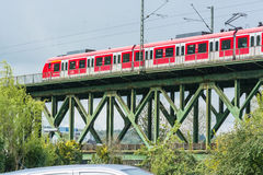 Red express train on the railway bridge in Essen Kettwig Royalty Free Stock Image