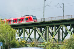 Red express train on the railway bridge in Essen Kettwig Royalty Free Stock Photo