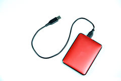 Red external hard disk isolated. Stock Photography