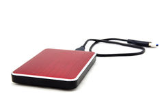 Red external hard drive with usb cable. Royalty Free Stock Photo