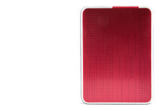 Red external hard drive with usb cable. Stock Image