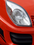 Red Eye. Head lamp on brand new bright red sports car royalty free stock photo