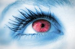 Red eye on blue face Stock Photo