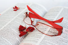 Red eye glasses on dictionary page Royalty Free Stock Photo