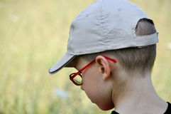 Red eyewear young boy Royalty Free Stock Images