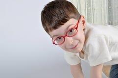 Red eyewear young boy Royalty Free Stock Image