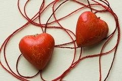red för cobwebbomullshjärta shapes två Arkivbild