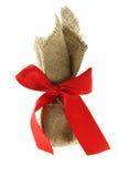 red för gåva för kanfas för bowaskburlap Fotografering för Bildbyråer