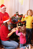 red för julfamiljhatt Royaltyfria Foton
