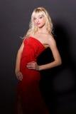 red för klänningflickaglamour Arkivfoton