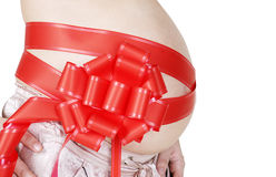 red för stor bow för buk gravid Arkivbilder