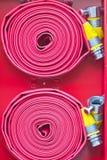 red för brandslang Fotografering för Bildbyråer