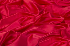 Red fabric. Bright red fabric wrinkled horizontal format Stock Photos