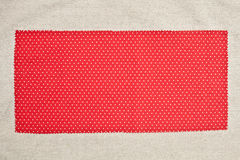 Red fabric. Red cotton fabric with white dots as a background stock images