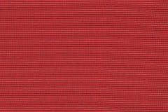 Red fabric background. Uniform texture Stock Photos
