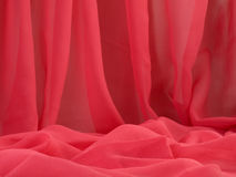 Red fabric. Background. Stock Photos