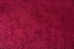 Red fabric background. Of a fluffy towel Stock Photos