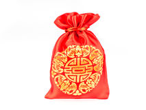 Red fabric bag or ang pow with Chinese style pattern on grey bac Royalty Free Stock Images