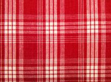 Red fabric in a cage. Royalty Free Stock Photos