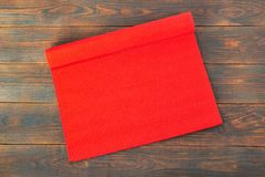 Red fabric christmas tablecloth on wooden table, background. Red fabric christmas tablecloth on wooden table, copy space stock images