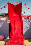 Red fabric covering the entrance of a tent Stock Photography