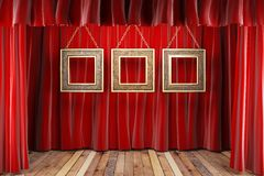 Red fabric curtain with frames Royalty Free Stock Photos