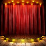 Red fabric curtain on golden stage Royalty Free Stock Images