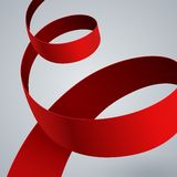 Red fabric curved ribbon on grey background Stock Photography