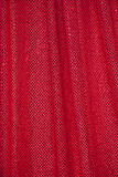 Red fabric with dots Royalty Free Stock Photo